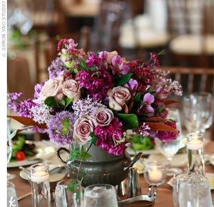 Roses, lilacs, hydrangeas and peonies arranged in bronze pitchers adorned each table.