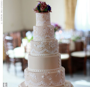 The towering six-tiered champagne-colored cake mirrored the lace on Kristen&#39;s dress and was even speckled with 14 karat gold edible paint.