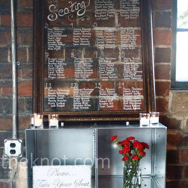 Instead of paper escort cards, Brynn's sister helped her create a framed piece of glass for the seating chart, on which she wrote the guests' table assignments.