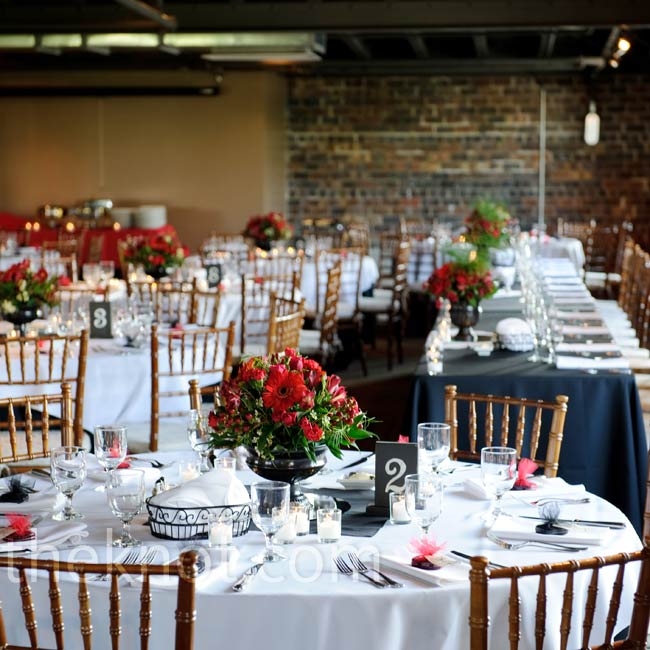 White and black tablecloths and red centerpieces brought the room together.