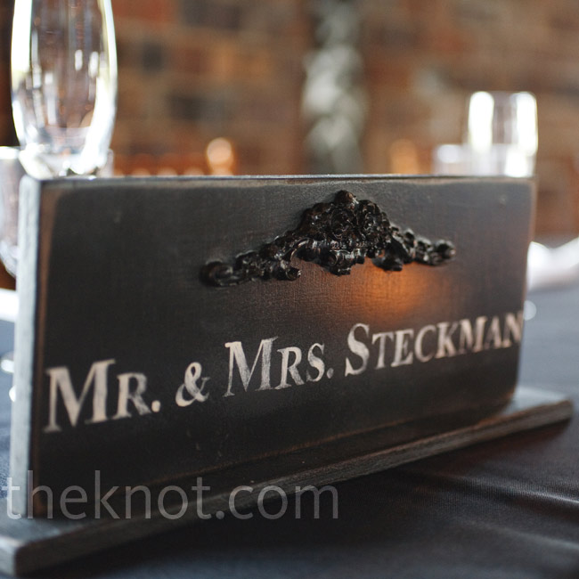 A vintage-style sign that matched the table numbers sat on the head table.