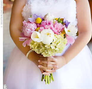 Hanh&#39;s soft bouquet tied in the colors of her palette with an assortment of peonies, craspedia, tulips, purple freesia and lime green hydrangeas.