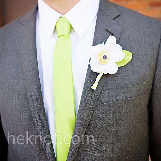 DIY fabric boutonnieres adorned with colorful buttons were the perfect complement to the couple's low-key aesthetic.
