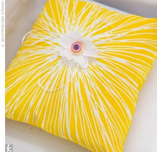 Brandon&#39;s nephew, Landen, carried a bright fabric ring pillow fashioned by the maid of honor.