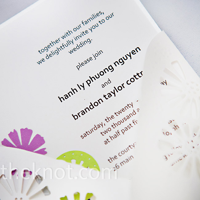 Though she purchased her invitations as part of a DIY kit, Hanh added a personal touch with paper flowers.