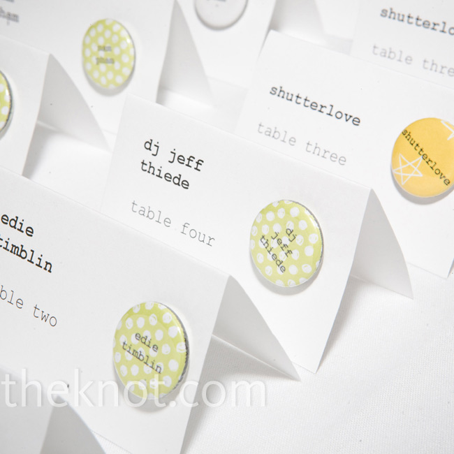 Mini pin buttons bearing each guest's full name dressed up the simple white tented escort cards.