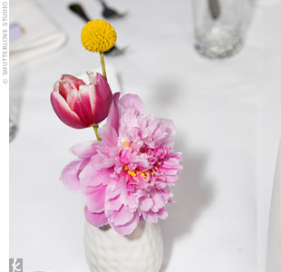 To capture a streamlined look, their florist used white IKEA vases on each table, filled with a few pink and yellow blooms.