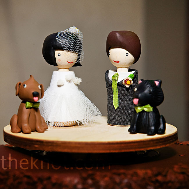 The custom cake topper was a rendition of Hanh, Brandon and their two dogs, Poot and Noodlebear.