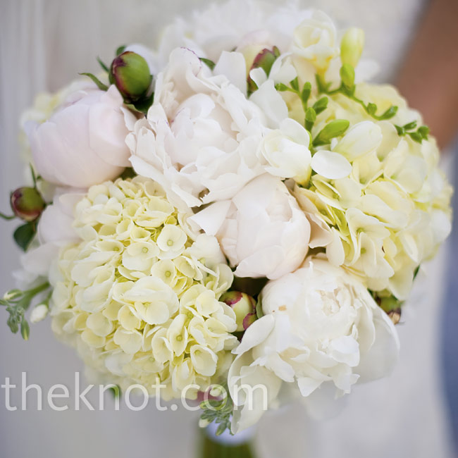 Laura carried a fuller-version of the bridesmaids' bouquets with fragrant white and pink peonies, freesia and hydrangeas. She personalized it with one of her grandfather's white, monogrammed handkerchiefs around the stems.