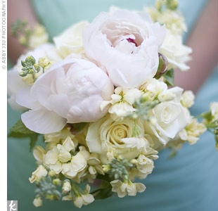 The bridesmaid dresses were a flattering backdrop to the pale pink peonies, white roses and freesia in their spring-inspired bouquets.