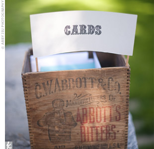 The couple collected their cards in a vintage Abbott's Bitters box.