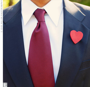 The bride painted wooden heart-shaped cut-outs red and attached them to pin backings for the boutonnieres.