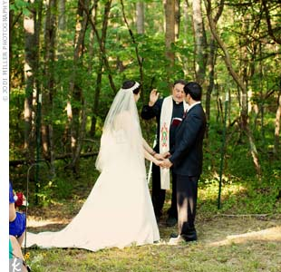 The bride and groom exchanged Christian vows in the blueberry fields on Staci's parents' farm.