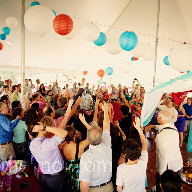 Red, turquoise and cream paper lanterns hung from the tent where the Hindu ceremony and reception were held.