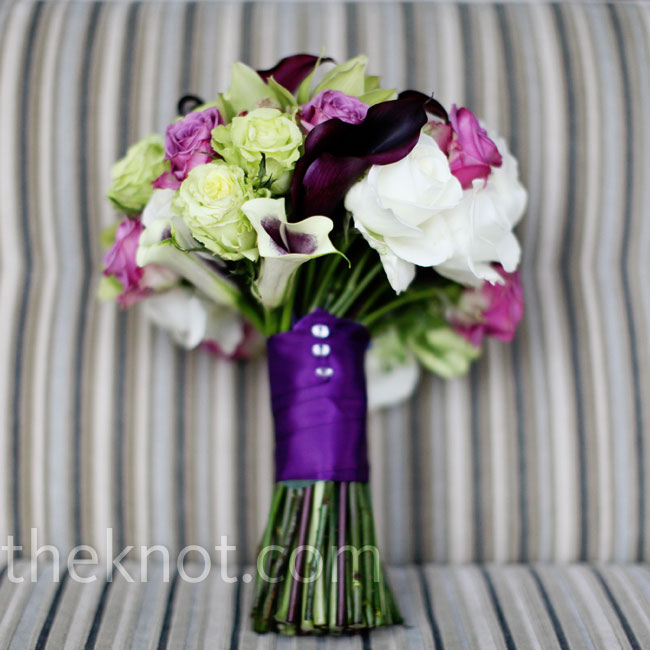 Elizabeth carried a bouquet of plum calla lilies, green cymbidium orchids, purple, green and white roses, and a few white calla lilies with purple highlights.