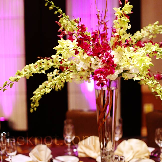 Two centerpiece designs alternated on tables. The taller ones were purple and green orchids and branches.