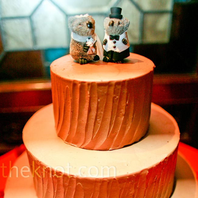 Mocha buttercream covered the three tiers of chocolate cake, topped with koala wedding toppers that Tony's brother had brought in from Sydney, Australia.