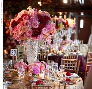 Round red and pink rose arrangements stood out in tall cut-crystal vases.
