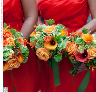 Loosely tied bouquets of orange roses and orchids had a natural, organic feel.