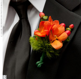 Coordinating with the bridesmaid bouquets, the guys wore orange orchids.