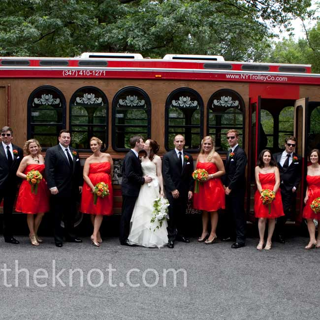 Deep orange bridesmaid dresses served as the base color from which all the other wedding details coordinated, including the trolleys that transported the guests from the ceremony to the reception.