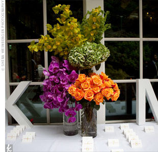 Custom-made monogram letters spruced up the escort card table and are now a cool keepsake.