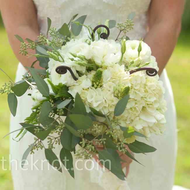 Fiddlehead ferns and green curly willow added texture and dimension to the white ranunculus and hydrangeas.