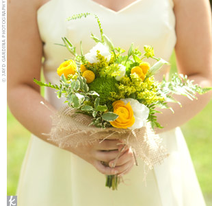 The bridesmaids carried craspedia and ranunculus mixed with wildflowers wrapped together in burlap for a natural look.