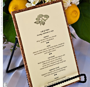 Corkboard backed the menu cards to complement the vineyard theme.