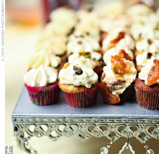 Instead of traditional wedding cake, a variety of cupcakes were served in flavors like Dom DeLuise (pistachio cake with ricotta cream cannoli frosting) and The Julia (pear brandy cake with brandy buttercream frosting), among others.