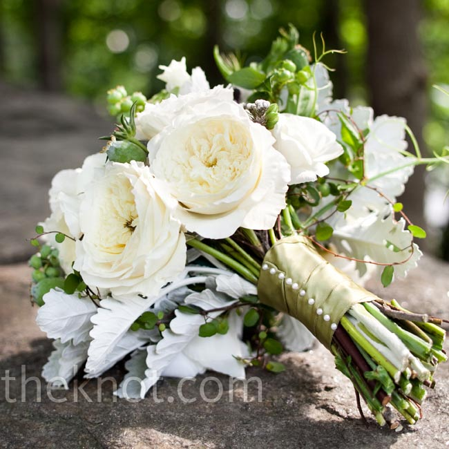 Shana trusted her florist to go wild with the bouquet -— resulting in an organic mix of blooms, foliage and ferns.