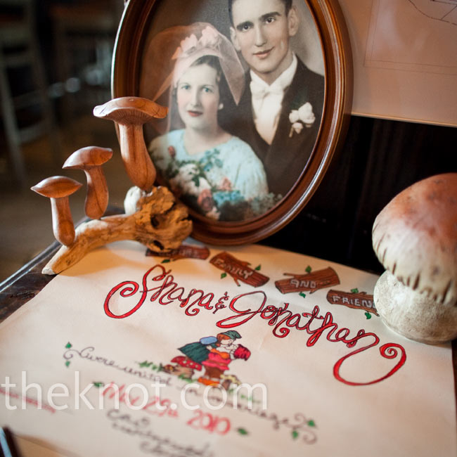 A vintage family photo and decorative mushrooms accented the woodland-themed guest book.