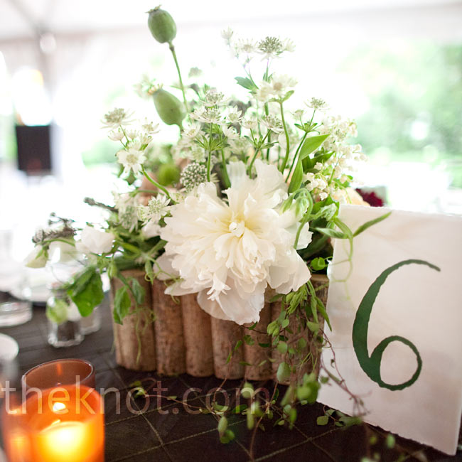 Wildflowers and fresh mushroom centerpieces gave the tables a lush forest look. Jonathan printed the table numbers himself.
