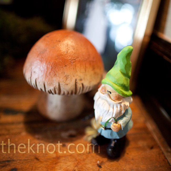 Family and friends helped the couple collect gnomes and mushrooms to decorate the reception space.