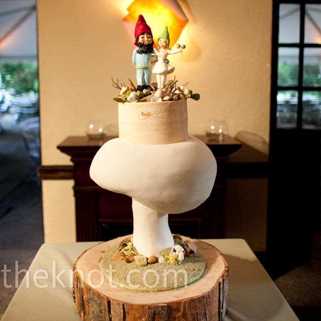 A giant mushroom-shaped red velvet cake was topped with sugar-made bride and groom gnome figurines -- a quirky finishing touch.