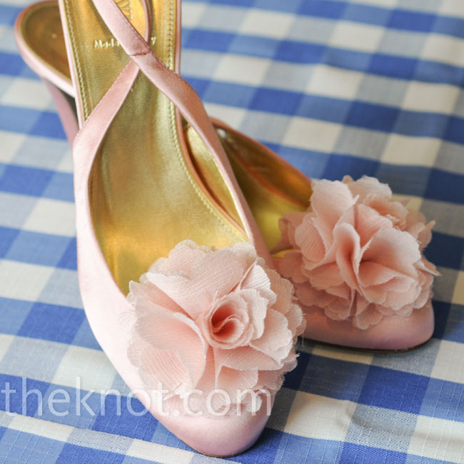 Vanessa bought pink satin sling backs and added flower clips she found online.