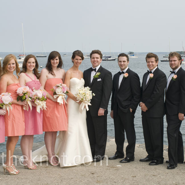 The bridesmaids alternated between pink and papaya dresses. The groomsmen matched in boutonnieres of coral garden roses.