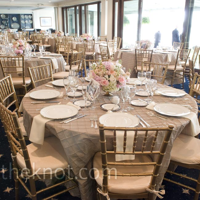 Taupe pintuck linens, ivory cloth napkins and gold chiavari chairs created a warm atmosphere.