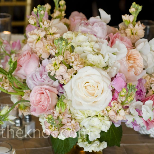 The tables featured lush, low arrangements of garden roses, peonies and hydrangeas.