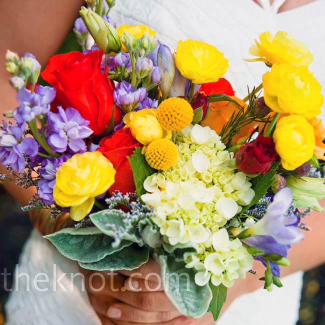 Marin carried a bouquet filled with casually arranged yellow, red, orange and purple blooms.