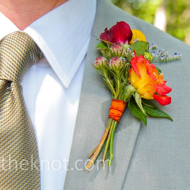 Jeff matched Marin's bouquet with an orange rose boutonniere backed by a variety of small yellow, red and purple flowers.