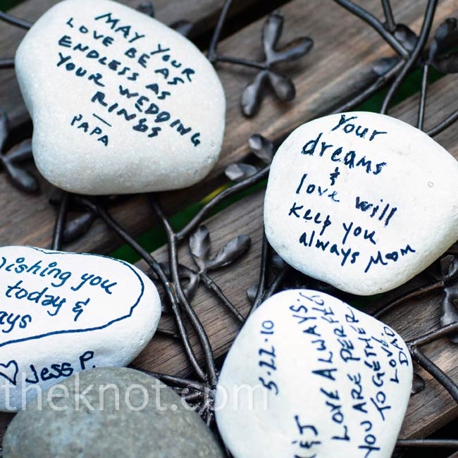 """We used rocks from Haiti as our guest book,"" says the bride. Each guest wrote well wishes, signed and decorated the stones."