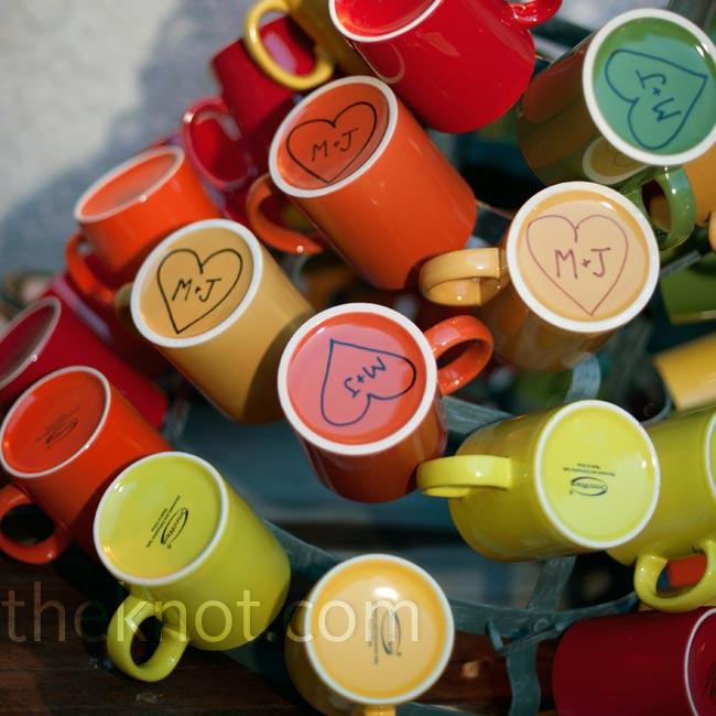 Guests took home red, green, orange, purple, citron or yellow mugs hand-painted with the couple's initials.