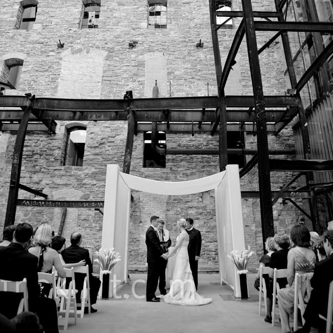 The exposed beams and bare brick in the Ruin Courtyard outside Mill City Museum was a unique, edgy backdrop to Sarah's and Zach's modern wedding.