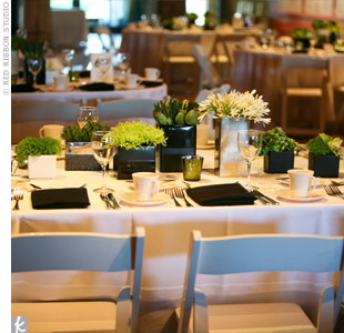 Crisp, white linens and black napkins gave the tables a fresh backdrop for an assortment of vases filled with green and white flowers.