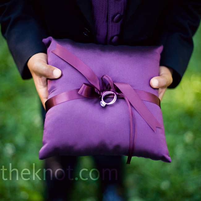 The ring bearers carried deep purple pillows.