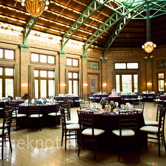 The couple chose Café Brauer because it felt uniquely Chicago. They kept the space simple with classic Chiavari chairs and purple table linens.