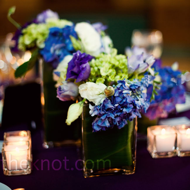 Hydrangeas and other in-season flowers in vases of varying heights decorated the reception tables.