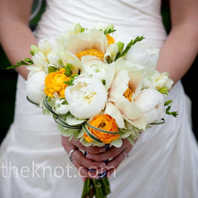 Nina carried a mix of orchids, ranunculus and peonies wrapped in black-and-white striped ribbon.