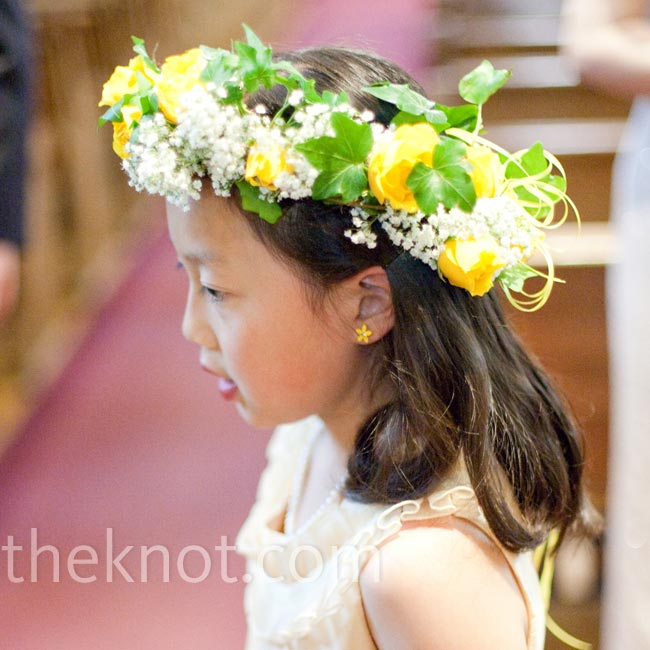 The couple's flower girls wore wreaths of yellow roses, baby's breath and greenery.